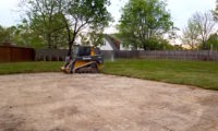John Deere Skidsteer pavement clearing